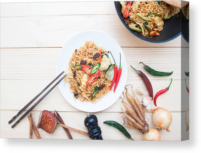 Thai Food Canvas Print featuring the photograph Close-Up Of Food On Table by Supreeya Chantalao / EyeEm
