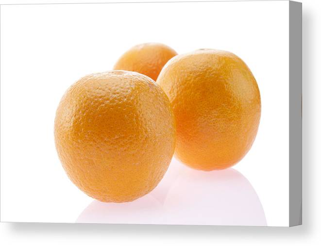 White Background Canvas Print featuring the photograph Close-up of oranges by IndiaPix/IndiaPicture