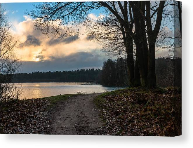 Scenics Canvas Print featuring the photograph Cloudy Sunrise by William Mevissen