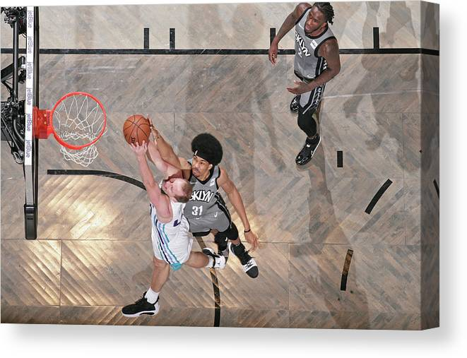 Nba Pro Basketball Canvas Print featuring the photograph Cody Zeller and Jarrett Allen by Nathaniel S. Butler