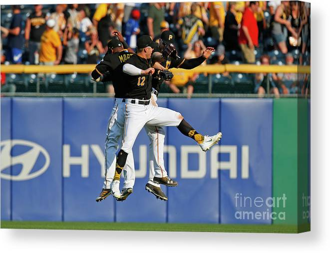 People Canvas Print featuring the photograph Corey Dickerson and Starling Marte by Justin K. Aller