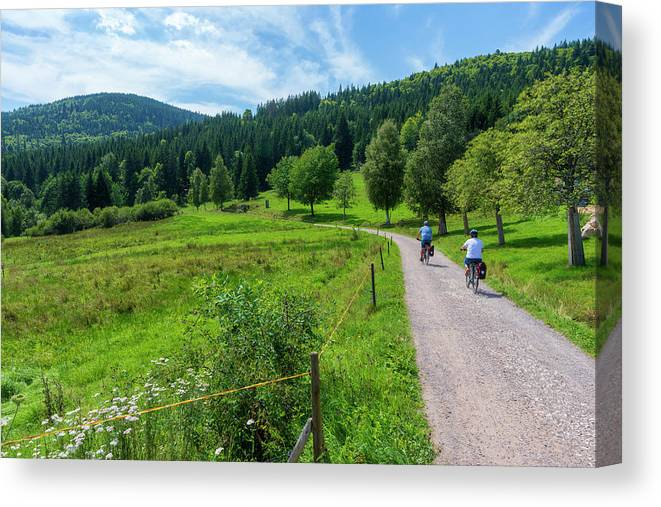 Color Canvas Print featuring the photograph Cyclists By The Lake Schluchsee by Vicen Photography