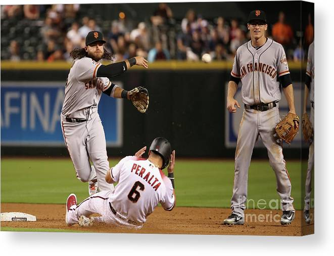 Double Play Canvas Print featuring the photograph David Peralta and Brandon Crawford by Christian Petersen