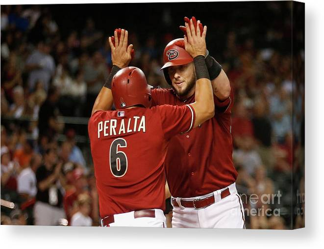 People Canvas Print featuring the photograph David Peralta and Jarrod Saltalamacchia by Christian Petersen