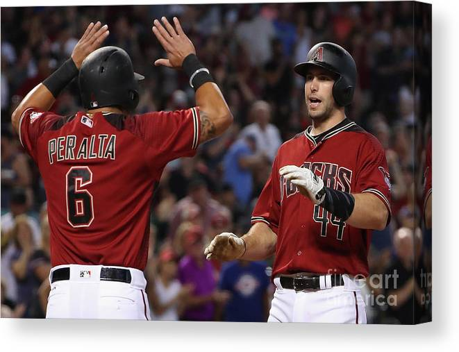 People Canvas Print featuring the photograph David Peralta and Paul Goldschmidt by Christian Petersen