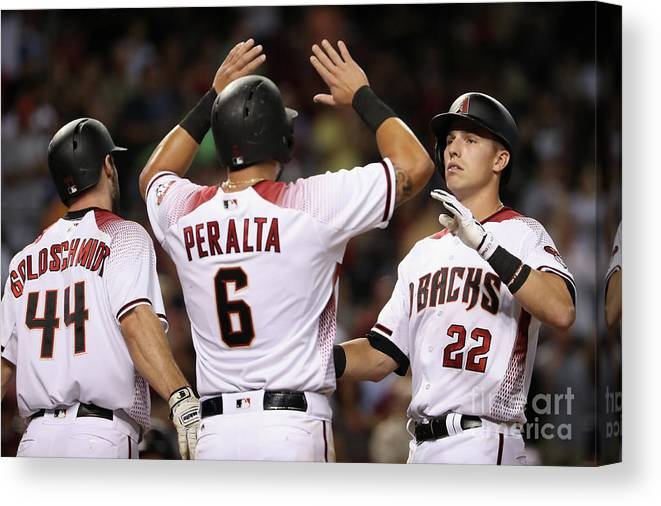 People Canvas Print featuring the photograph David Peralta, Paul Goldschmidt, and Jake Lamb by Christian Petersen