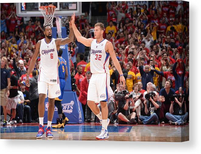 Playoffs Canvas Print featuring the photograph Deandre Jordan and Blake Griffin by Andrew D. Bernstein
