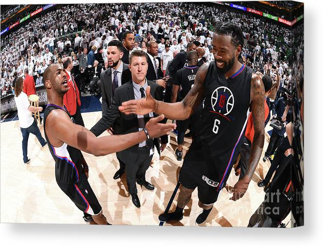 Playoffs Canvas Print featuring the photograph Deandre Jordan and Chris Paul by Andrew D. Bernstein