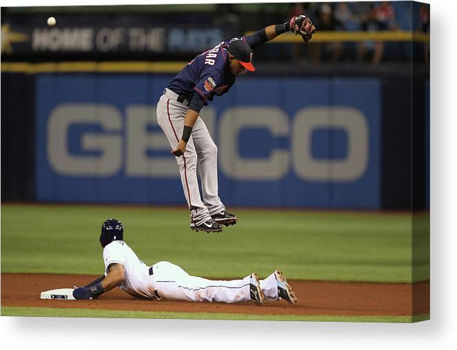 American League Baseball Canvas Print featuring the photograph Desmond Jennings and Eduardo Escobar by Scott Iskowitz