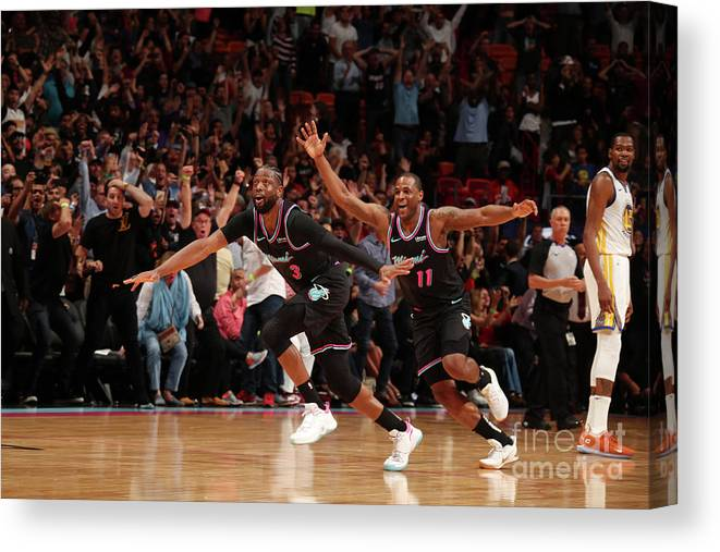 Nba Pro Basketball Canvas Print featuring the photograph Dion Waiters and Dwyane Wade by Issac Baldizon