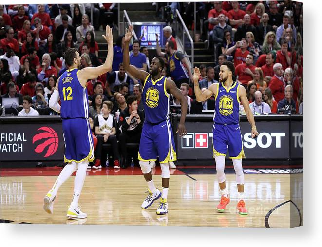 Playoffs Canvas Print featuring the photograph Draymond Green, Stephen Curry, and Andrew Bogut by Joe Murphy