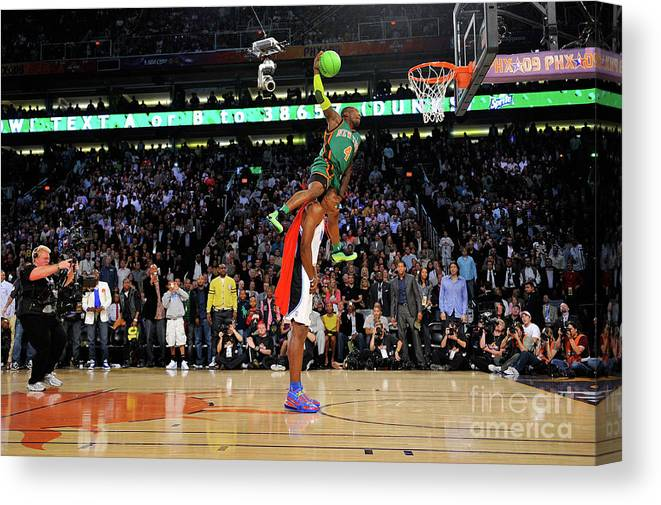 Nba Pro Basketball Canvas Print featuring the photograph Dwight Howard and Nate Robinson by Jesse D. Garrabrant