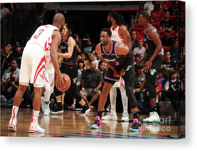 Nba Pro Basketball Canvas Print featuring the photograph Dwyane Wade and Chris Paul by Issac Baldizon