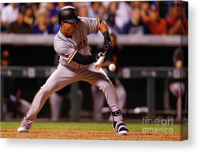 American League Baseball Canvas Print featuring the photograph Ehire Adrianza by Justin Edmonds