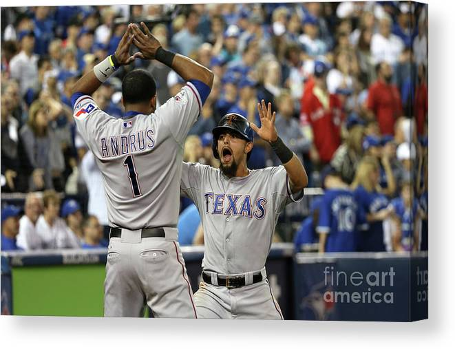 Game Two Canvas Print featuring the photograph Elvis Andrus and Rougned Odor by Tom Szczerbowski