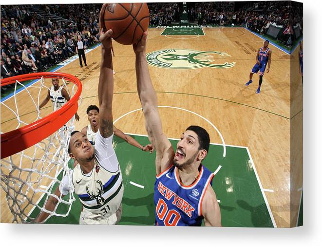 Nba Pro Basketball Canvas Print featuring the photograph Enes Kanter and John Henson by Gary Dineen