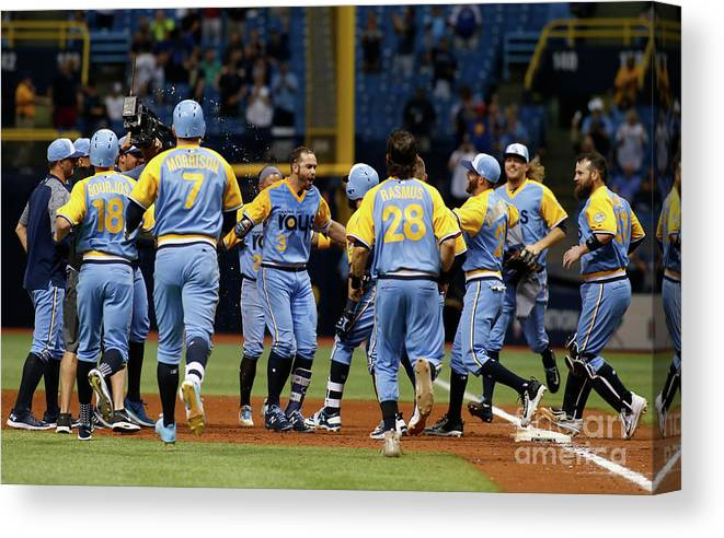 People Canvas Print featuring the photograph Evan Longoria and Peter Bourjos by Brian Blanco