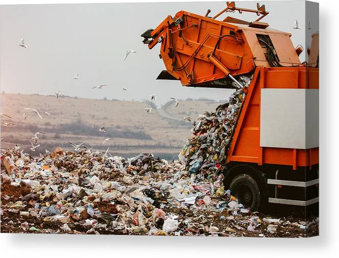 Environmental Damage Canvas Print featuring the photograph Garbage truck dumping the garbage by Choice76