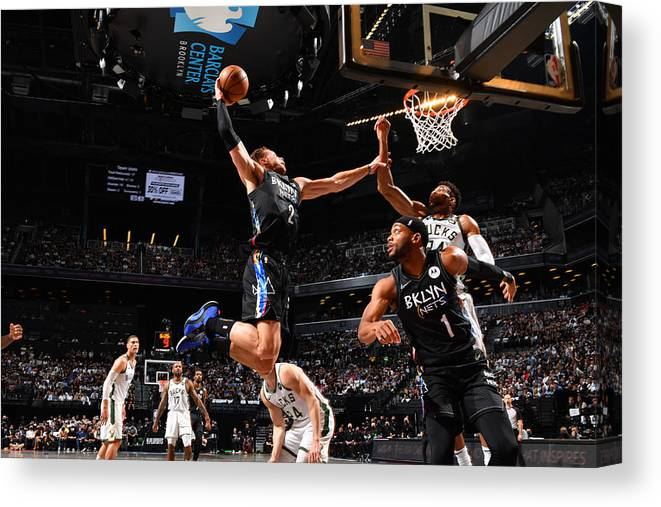 Nba Pro Basketball Canvas Print featuring the photograph Giannis Antetokounmpo and Blake Griffin by Jesse D. Garrabrant