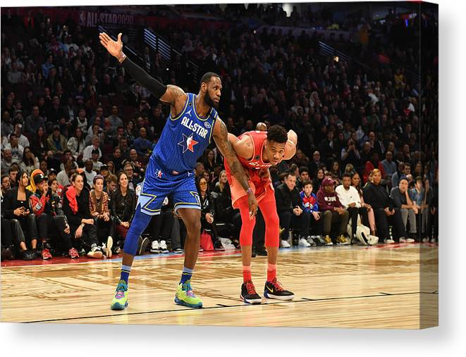 Nba Pro Basketball Canvas Print featuring the photograph Giannis Antetokounmpo and Lebron James by Jesse D. Garrabrant