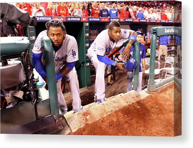 American League Baseball Canvas Print featuring the photograph Hanley Ramirez And Yasiel Puig by Jamie Squire