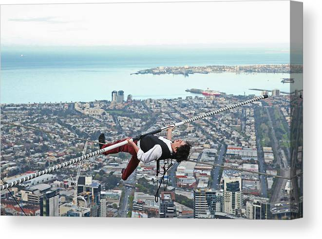 Artist Canvas Print featuring the photograph High-wire Artist Kane Petersen Performs Tightrope Walk Over Melbourne CBD by Scott Barbour