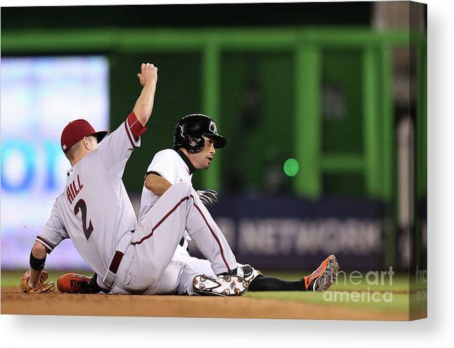 People Canvas Print featuring the photograph Ichiro Suzuki and Aaron Hill by Rob Foldy