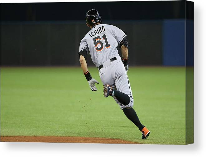 People Canvas Print featuring the photograph Ichiro Suzuki by Tom Szczerbowski