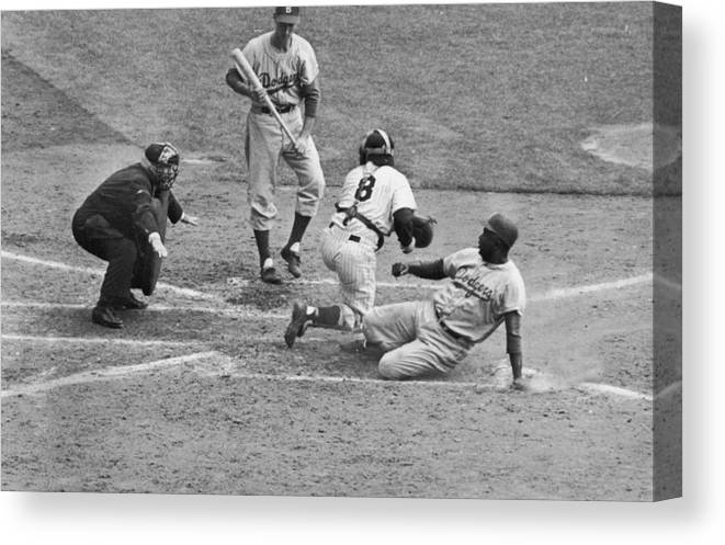 People Canvas Print featuring the photograph Jackie Robinson and Yogi Berra by Hulton Archive