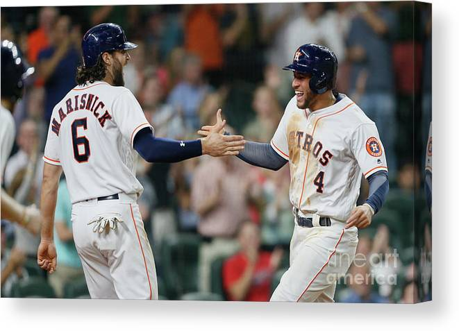 American League Baseball Canvas Print featuring the photograph Jake Marisnick and George Springer by Bob Levey
