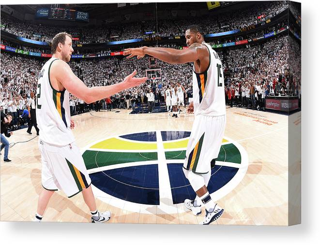 Playoffs Canvas Print featuring the photograph Joe Ingles and Derrick Favors by Andrew D. Bernstein
