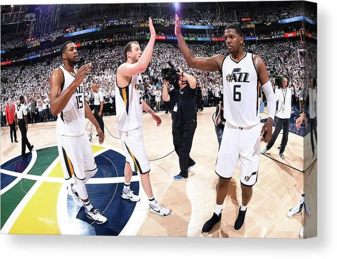 Playoffs Canvas Print featuring the photograph Joe Ingles, Joe Johnson, and Derrick Favors by Andrew D. Bernstein