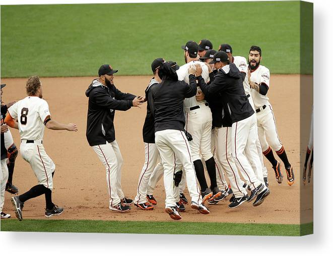 Playoffs Canvas Print featuring the photograph Joe Panik and Brandon Belt by Ezra Shaw