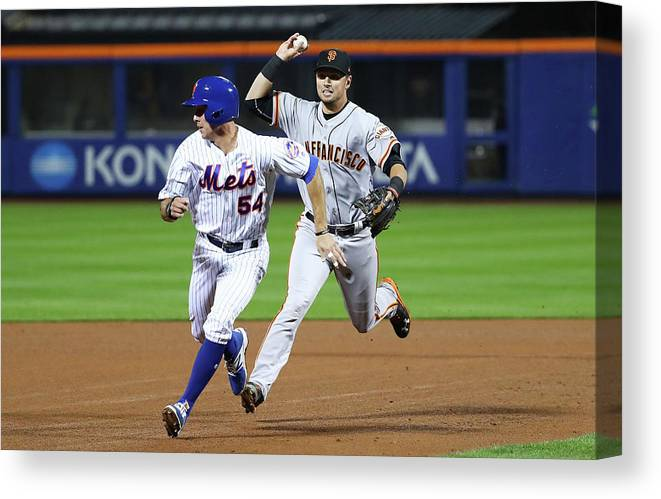 Playoffs Canvas Print featuring the photograph Joe Panik and Brandon Crawford by Al Bello