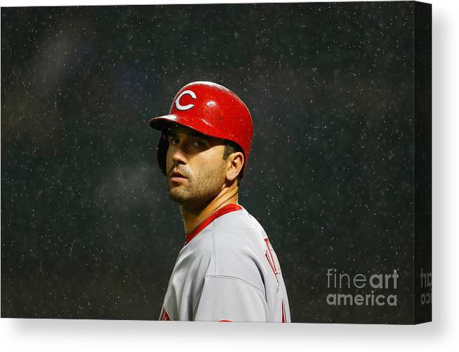 American League Baseball Canvas Print featuring the photograph Joey Votto by Mike Stobe