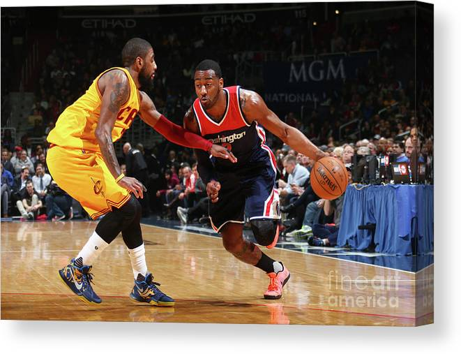 Nba Pro Basketball Canvas Print featuring the photograph John Wall and Kyrie Irving by Ned Dishman