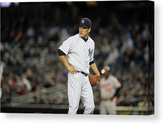American League Baseball Canvas Print featuring the photograph Jonathan Schoop and Masahiro Tanaka by Rob Tringali