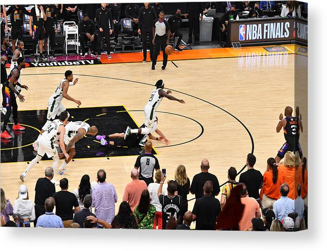 Playoffs Canvas Print featuring the photograph Jrue Holiday and Devin Booker by Jesse D. Garrabrant