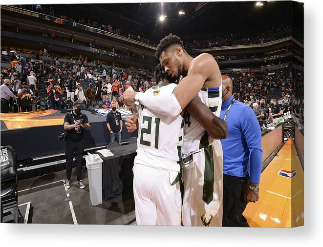Playoffs Canvas Print featuring the photograph Jrue Holiday and Giannis Antetokounmpo by Andrew D. Bernstein