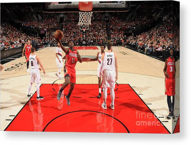 Nba Pro Basketball Canvas Print featuring the photograph Jrue Holiday by Cameron Browne