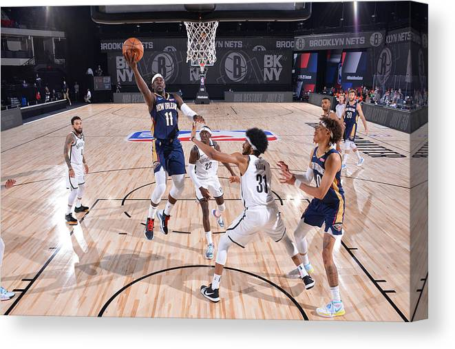 Nba Pro Basketball Canvas Print featuring the photograph Jrue Holiday by Jesse D. Garrabrant