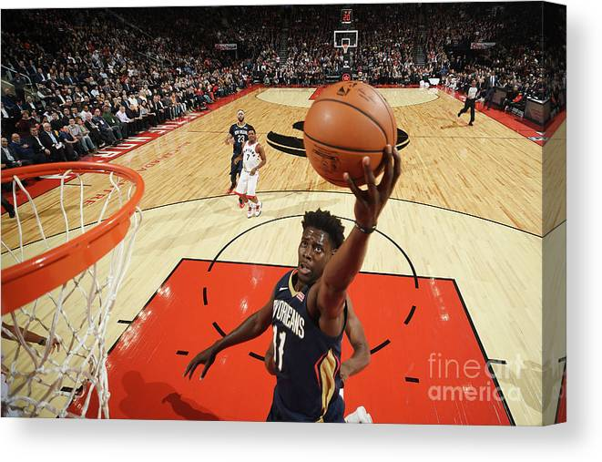Nba Pro Basketball Canvas Print featuring the photograph Jrue Holiday by Ron Turenne