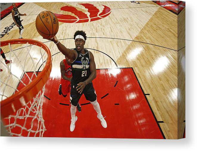 Nba Pro Basketball Canvas Print featuring the photograph Jrue Holiday by Scott Audette