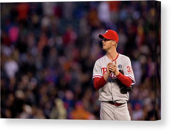 Defeat Canvas Print featuring the photograph Justin Morneau and Kyle Kendrick by Justin Edmonds