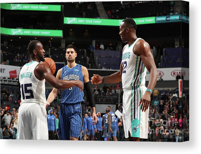 Kemba Walker Canvas Print featuring the photograph Kemba Walker and Dwight Howard by Kent Smith