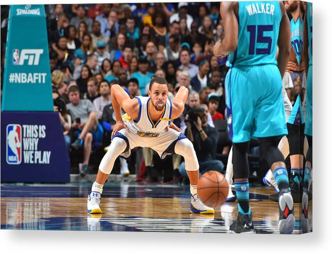 Kemba Walker Canvas Print featuring the photograph Kemba Walker and Stephen Curry by Jesse D. Garrabrant