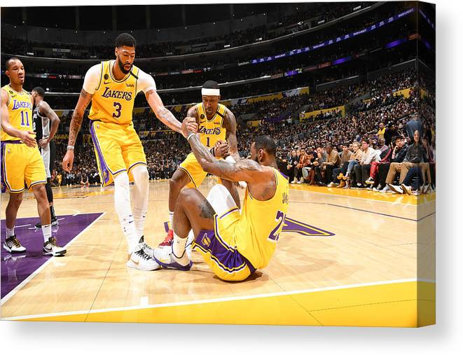 Nba Pro Basketball Canvas Print featuring the photograph Kentavious Caldwell-pope, Anthony Davis, and Lebron James by Andrew D. Bernstein