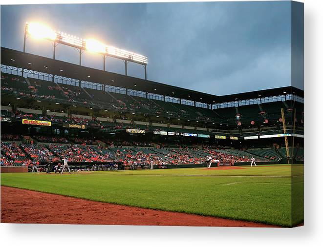 American League Baseball Canvas Print featuring the photograph Kevin Gausman and Melky Cabrera by Rob Carr