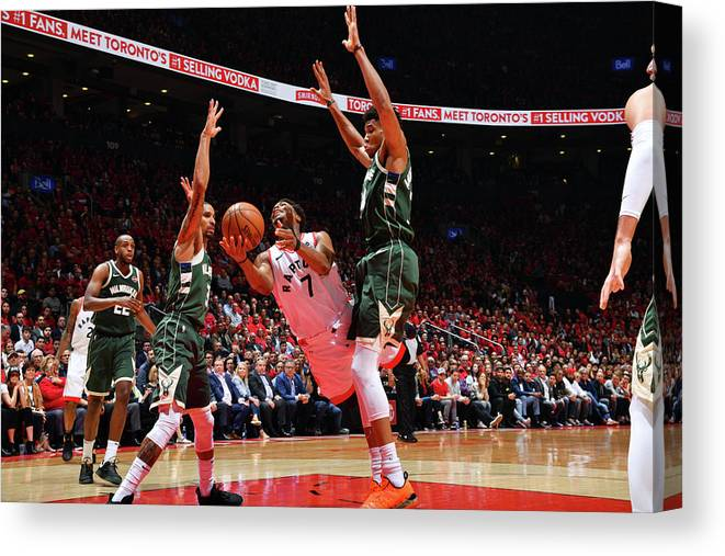 Playoffs Canvas Print featuring the photograph Kyle Lowry and Giannis Antetokounmpo by Jesse D. Garrabrant