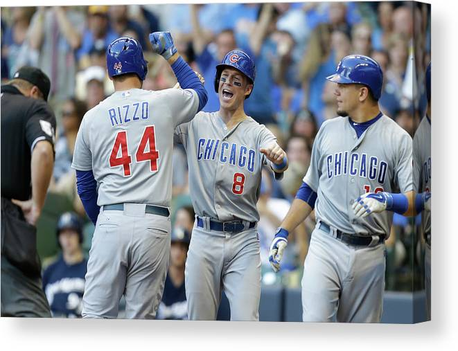 Three Quarter Length Canvas Print featuring the photograph Kyle Schwarber, Anthony Rizzo, and Chris Coghlan by Mike Mcginnis